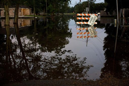 cool Search for living, dead: Louisiana fights back from flooding