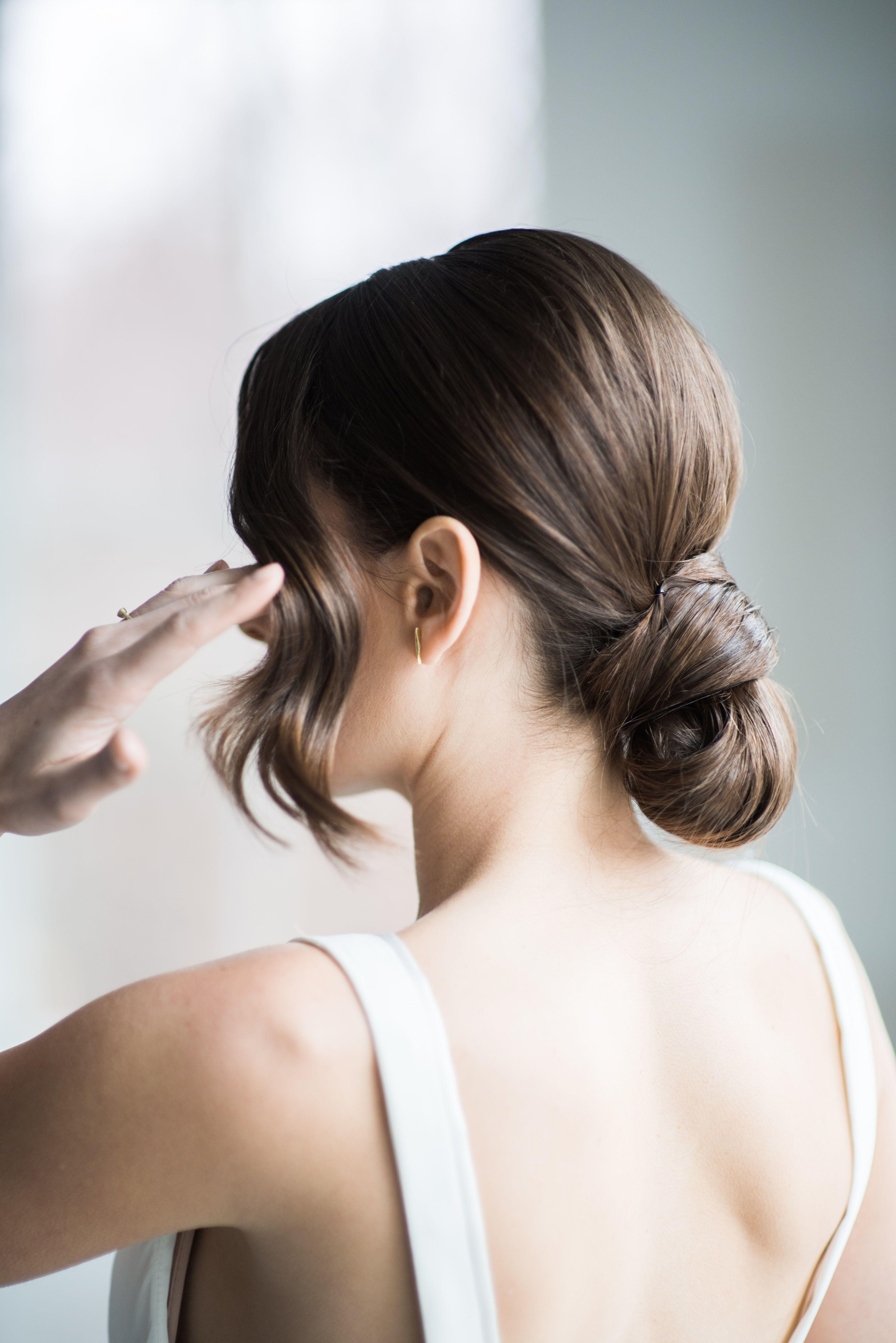 modern simple low bun updo with bangs   wedding hair in 2019