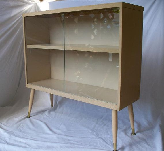 mid century modern blonde formica bookcase sliding glass doors