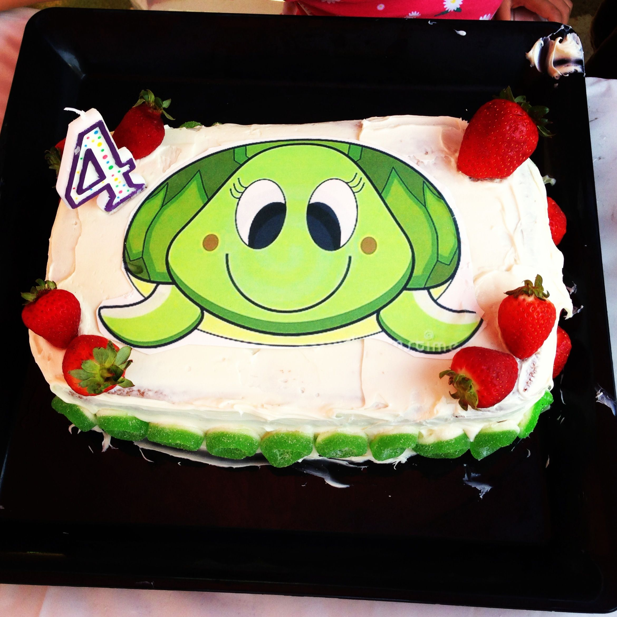 Homemade strawberry cake with edible picture turtle