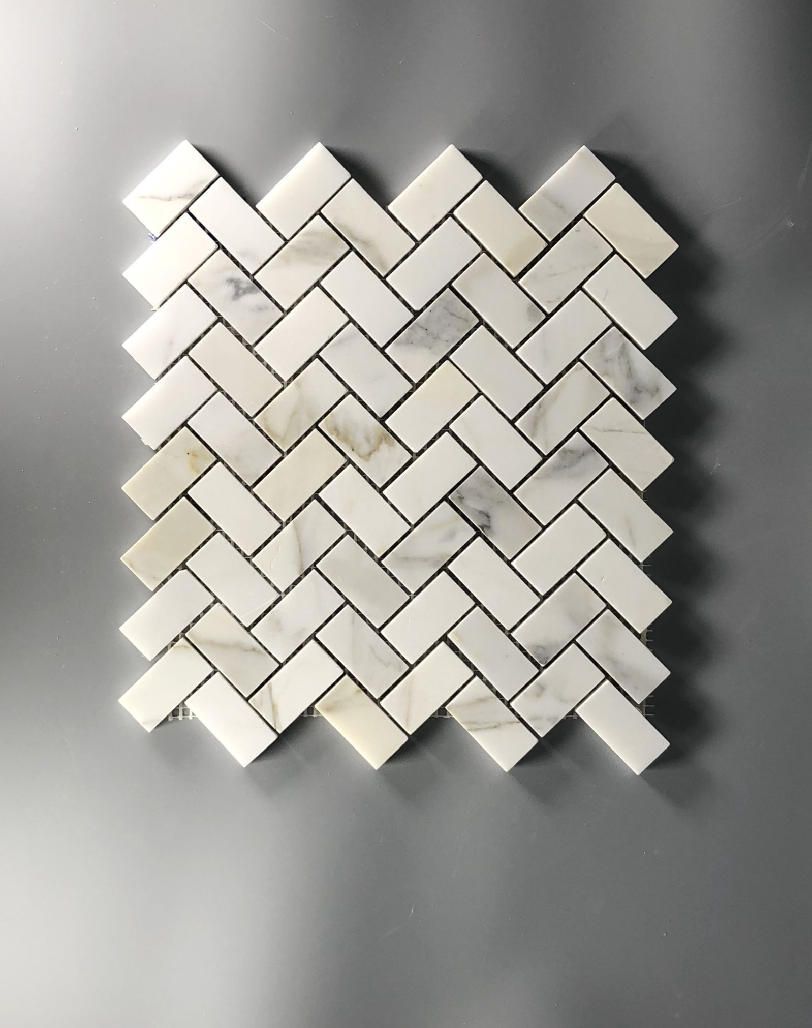 Herringbone tile https bar myshopify com products calcutta gold marble mosaic bathroom floor kitchen backsplashhttps www tilebuys also best designer white  grey images on pinterest
