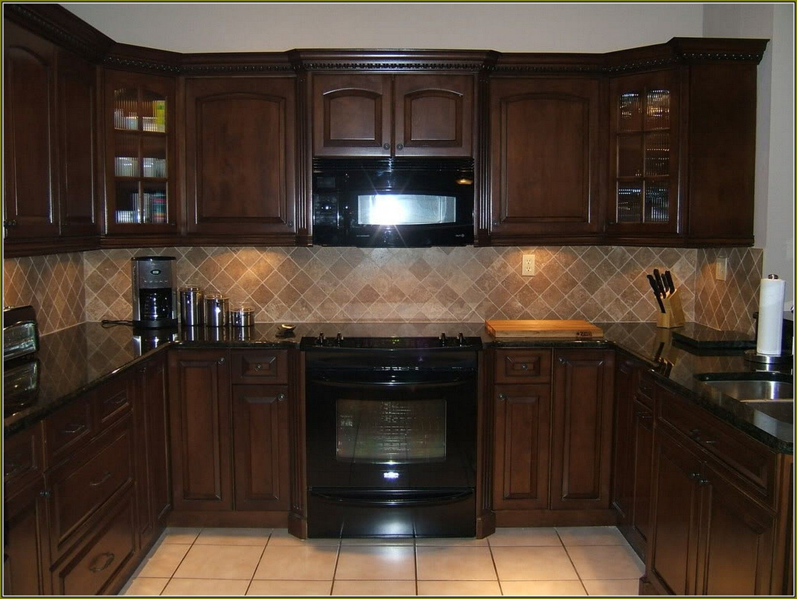 Walnut Kitchen Cabinets With Black Appliances Brown Kitchen Cabinets Black Appliances Kitchen Brown Kitchens