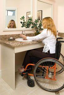 Wheelchair user at bathroom sink bathroom ideas for Wheelchair accessible kitchen ideas