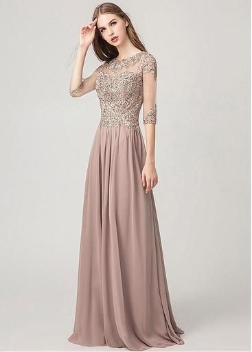 4c30b5bf320 The Dress Features A Jewel Neckline Bodice And Has Illusion Sleeves