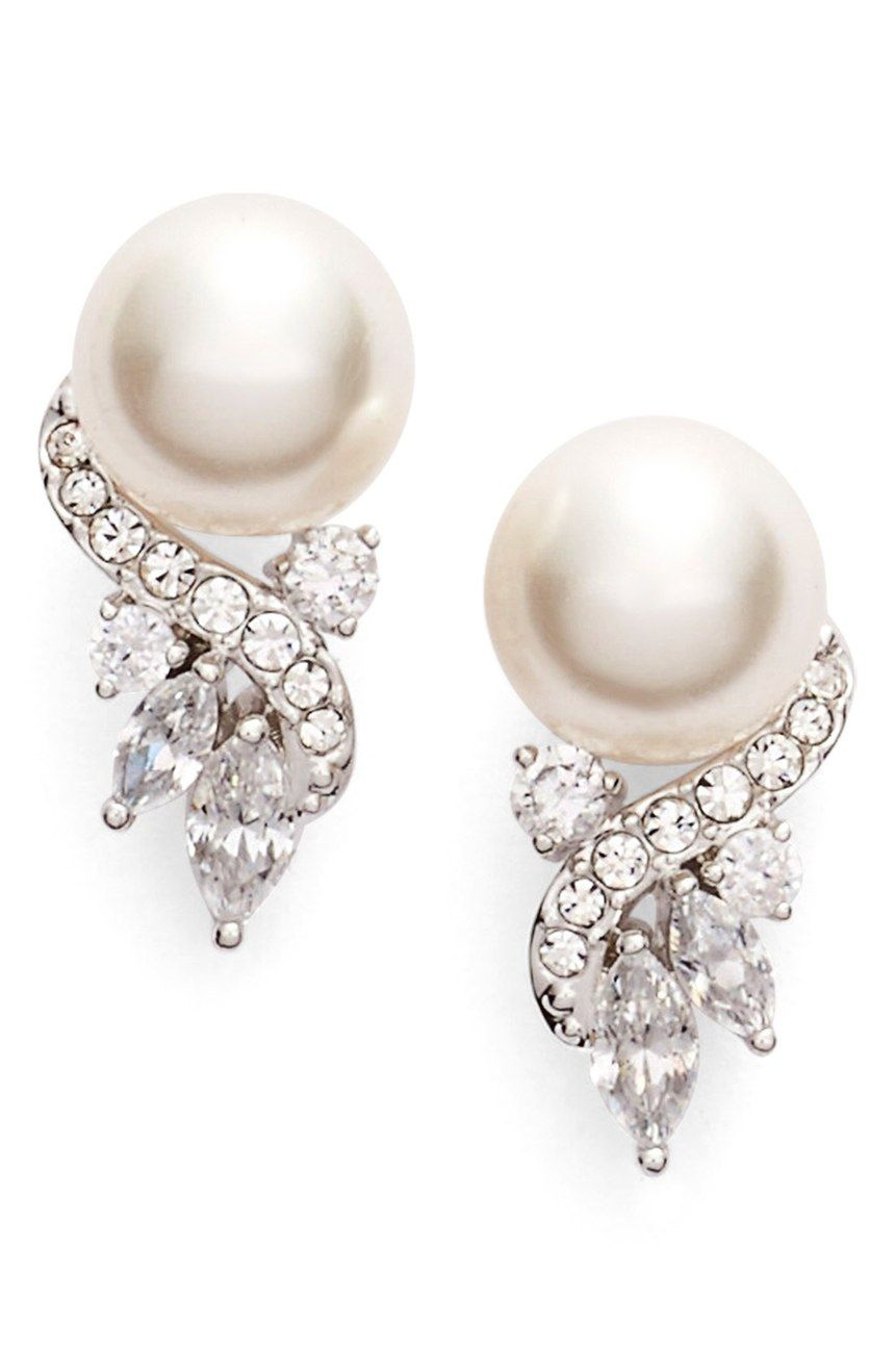 These glamorous drop earrings topped with luminous pearls are sure to sparkle with dazzling crystals.