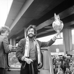 Denis Mortimore holds the League Championship trophy in 1981*