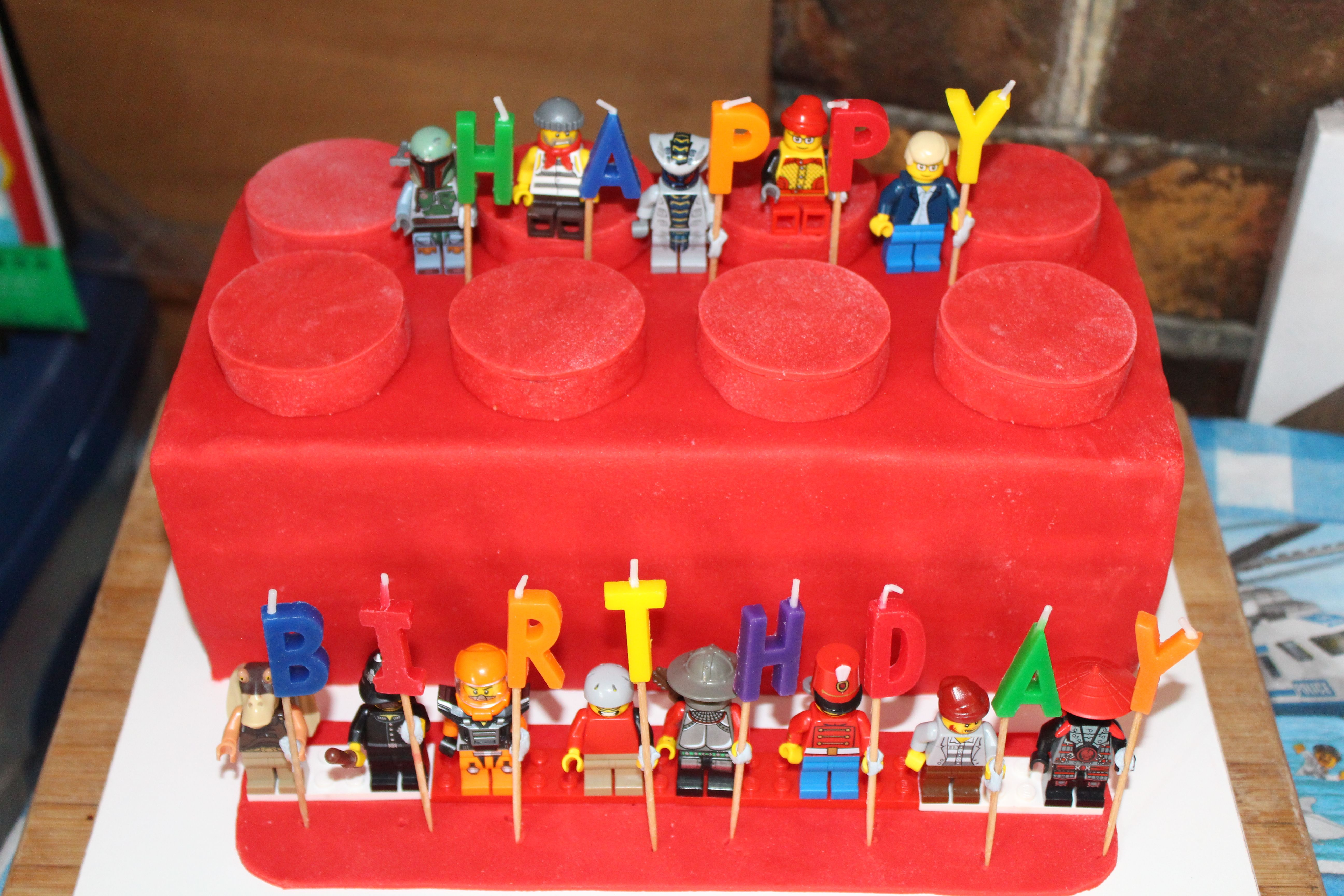 Lego Brick Cake Finished Complete With Mini Figures Holding Happy Birthday Candles