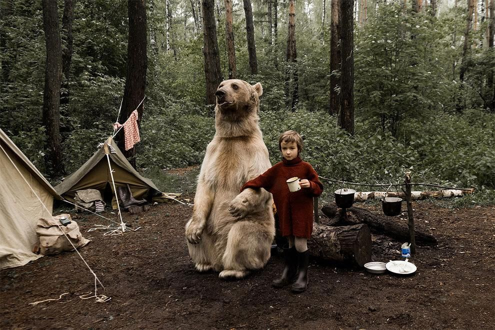 Russian Family Playing with a Real Bear Stepan at Picnic in the Forest, http://photovide.com/russian-family-playing-bear-stepan/