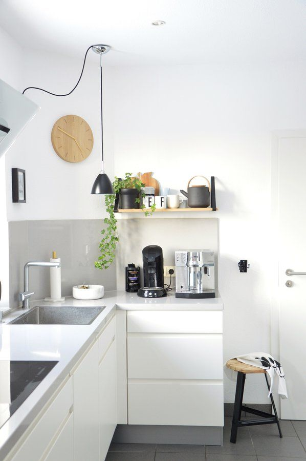 Scandinavian Inspired White Kitchen With A Stool, A Beautifully Decorated  Shelf And A Black Pendant Light. Pictures Gallery