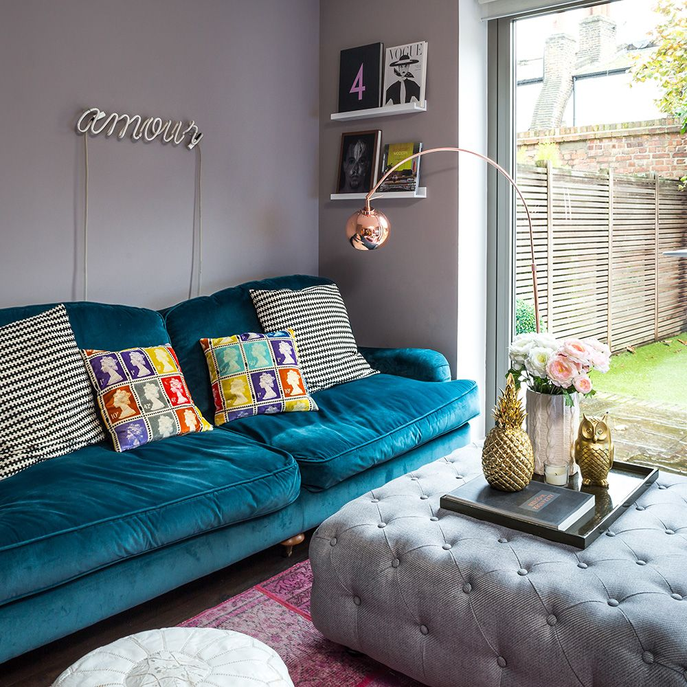 grey living room with signature blue velvet slouch sofa