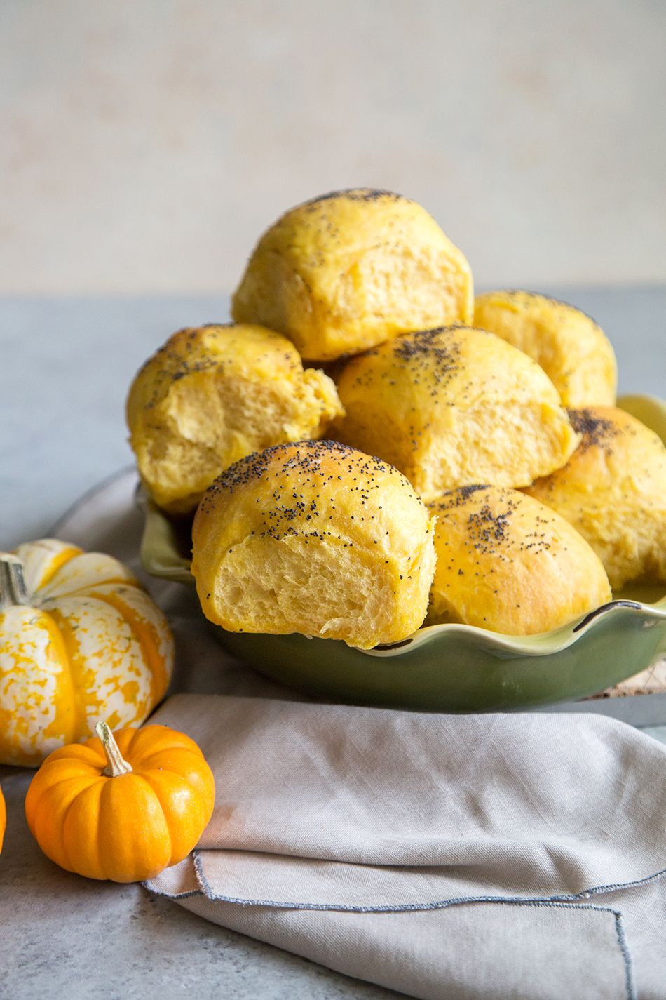 These super soft pumpkin bread rolls are the perfect accompaniment to any autumn meal! Made with pumpkin puree, these rolls are savory