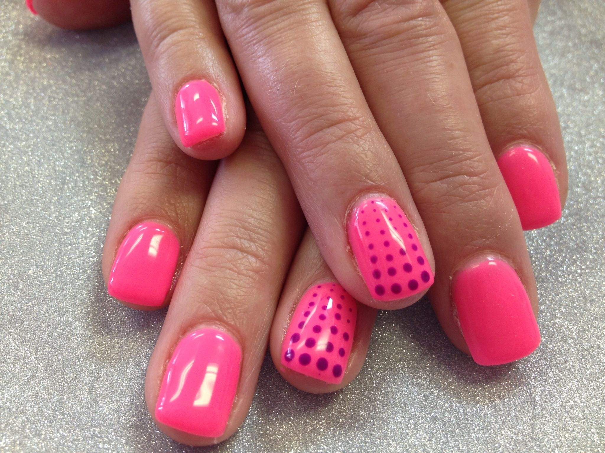 Gel nails in a full Colour. Neon pink with violet polka dots on ring ...