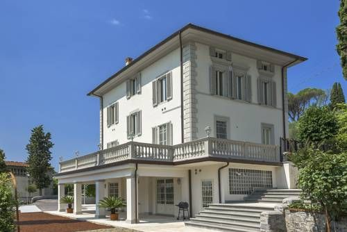 Villa Liberty Montecatini Montecatini Terme Featuring a terrace with garden views, Villa Liberty Montecatini is a villa, located in Montecatini Terme. You can fire up the barbecue for a tasty meal and enjoy the garden in fair weather. Free WiFi is available throughout the property.