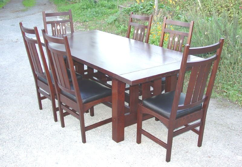 Shown without leaves surrounded by six inlaid dining chairs ...