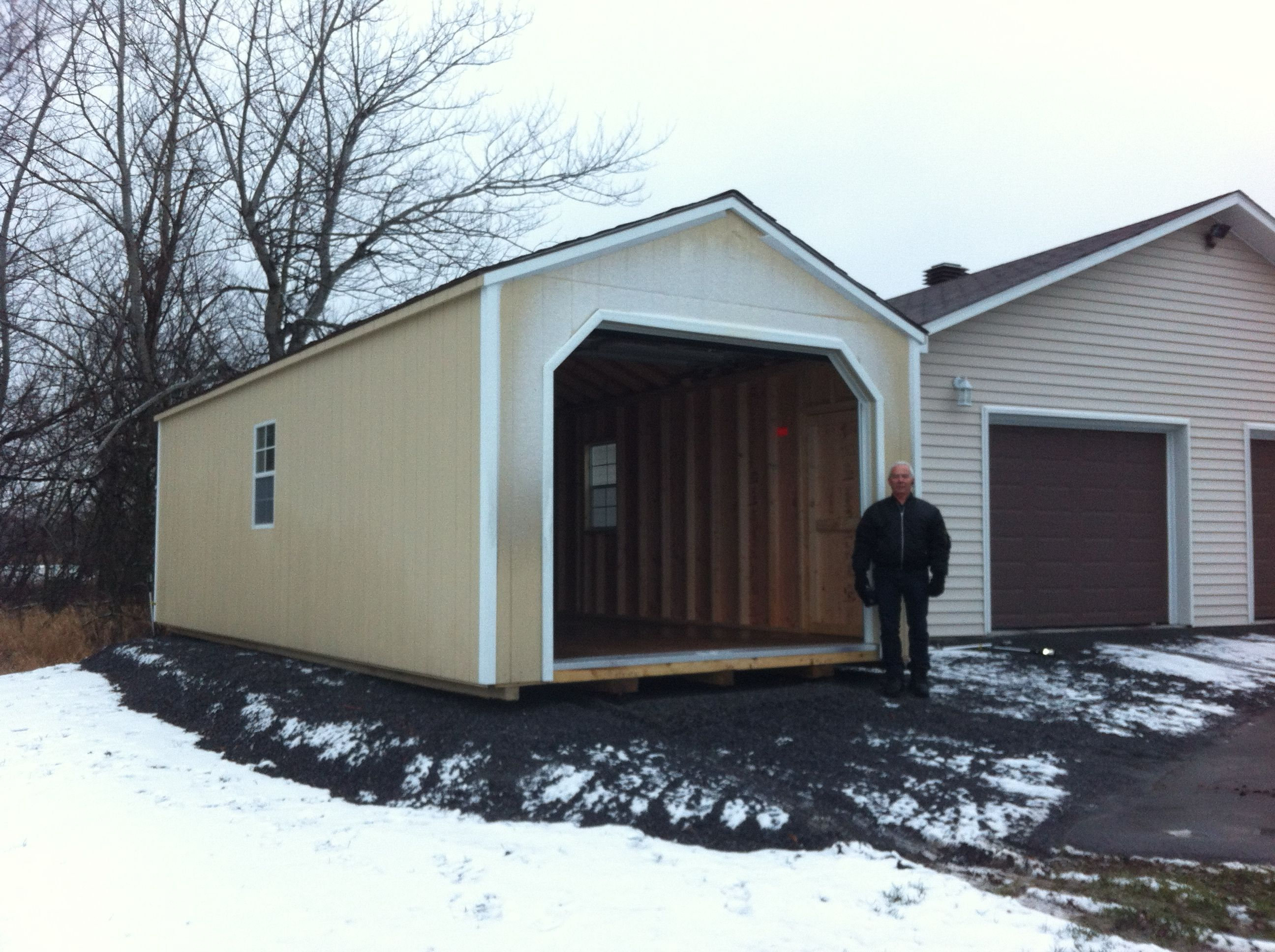 12' X 28' Wooden Portable Garage - Delivered Fully Assembled and Ready for Immediate Use...Visit NorthCountrySheds.com for more info..