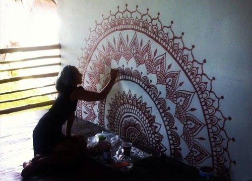 Mehndi For The Inspired Artist : Darcy paints a mehndi inspired mural on the yoga studio wall at