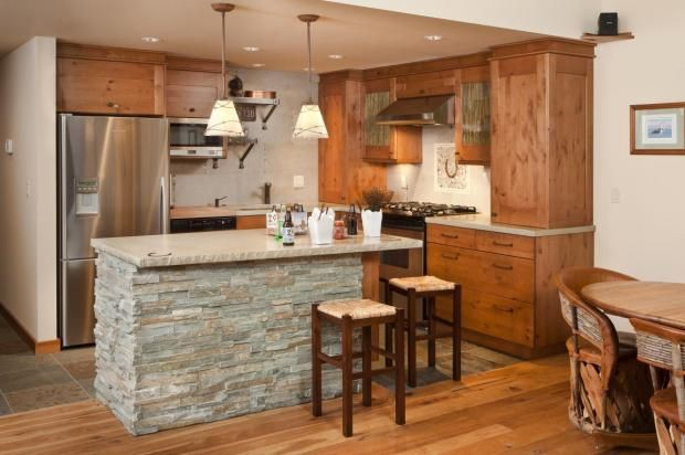 Knotty Alder Cabinets And Hickory Floors With Some Slate Are