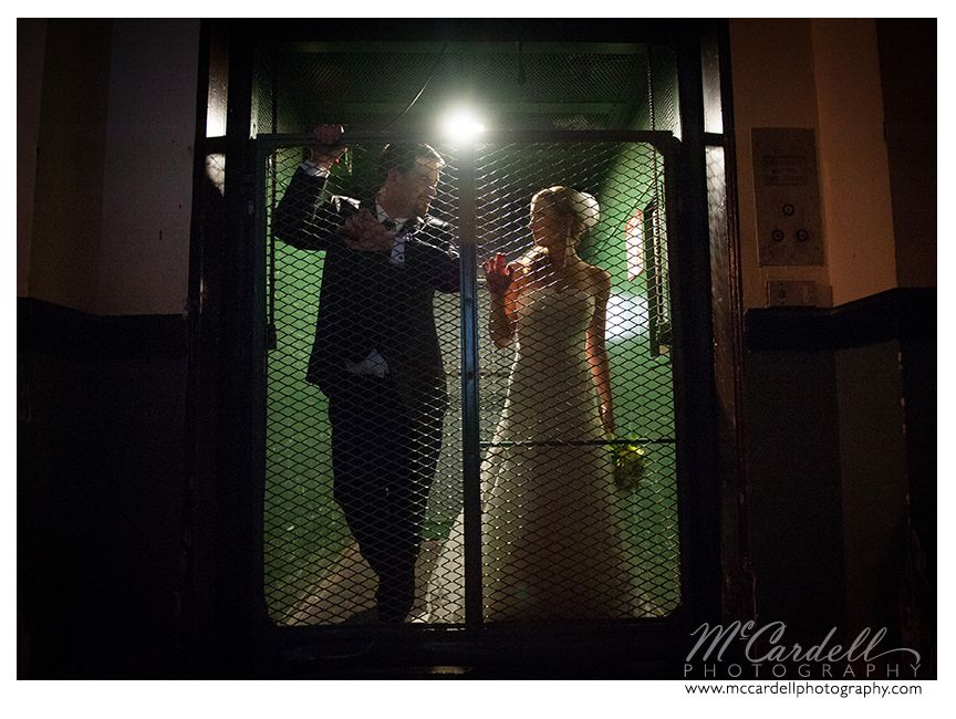 Bride and Groom in warehouse elevator. Artsy, edgy, cool. (www.mccardellphotography.com)