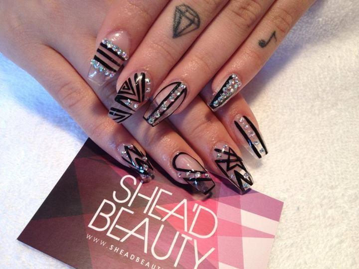 Simple Black Nail Art With Rhinestone Accents