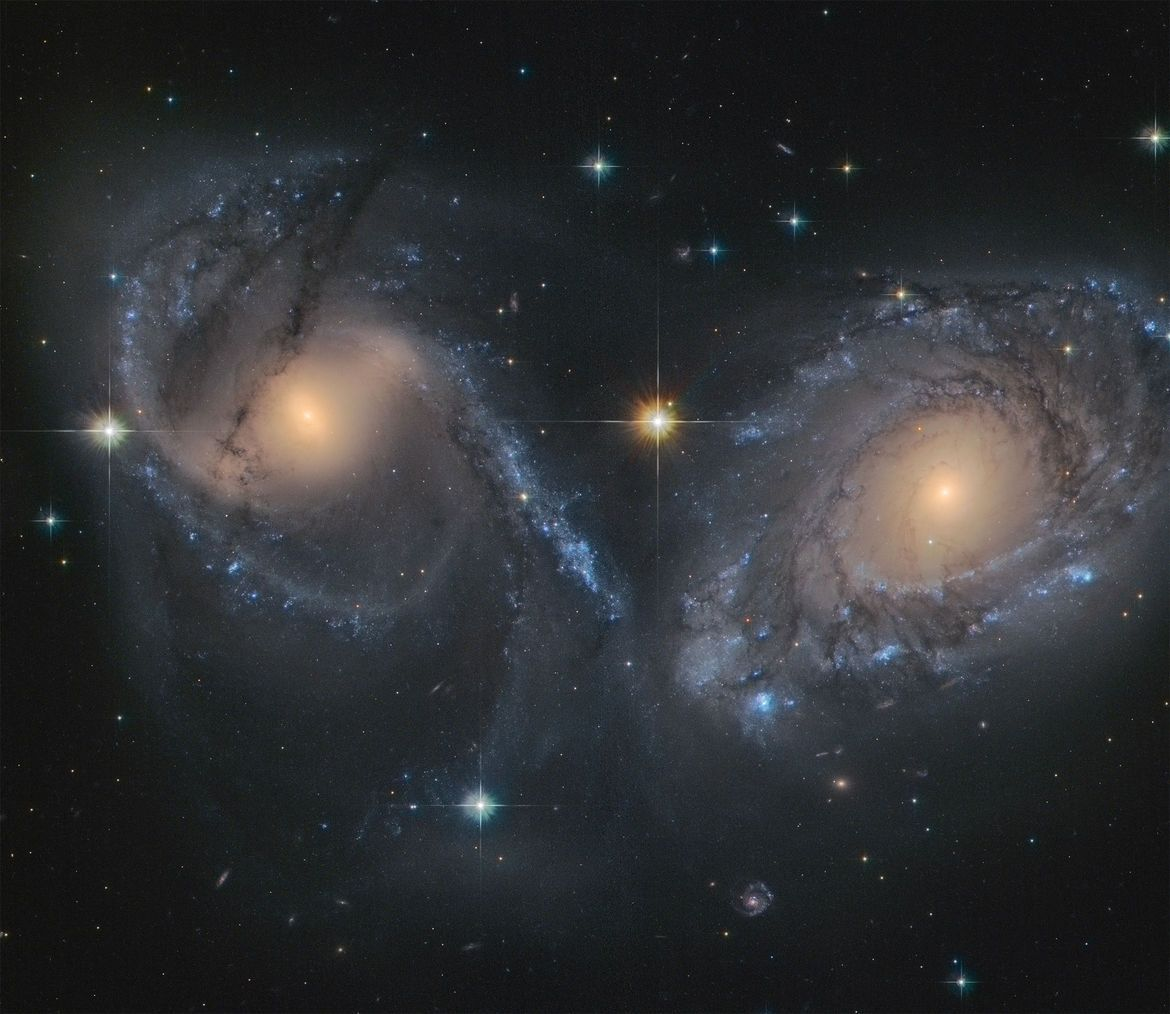 NGC 6769 (right) and 6770 (left) are two spiral galaxies ...