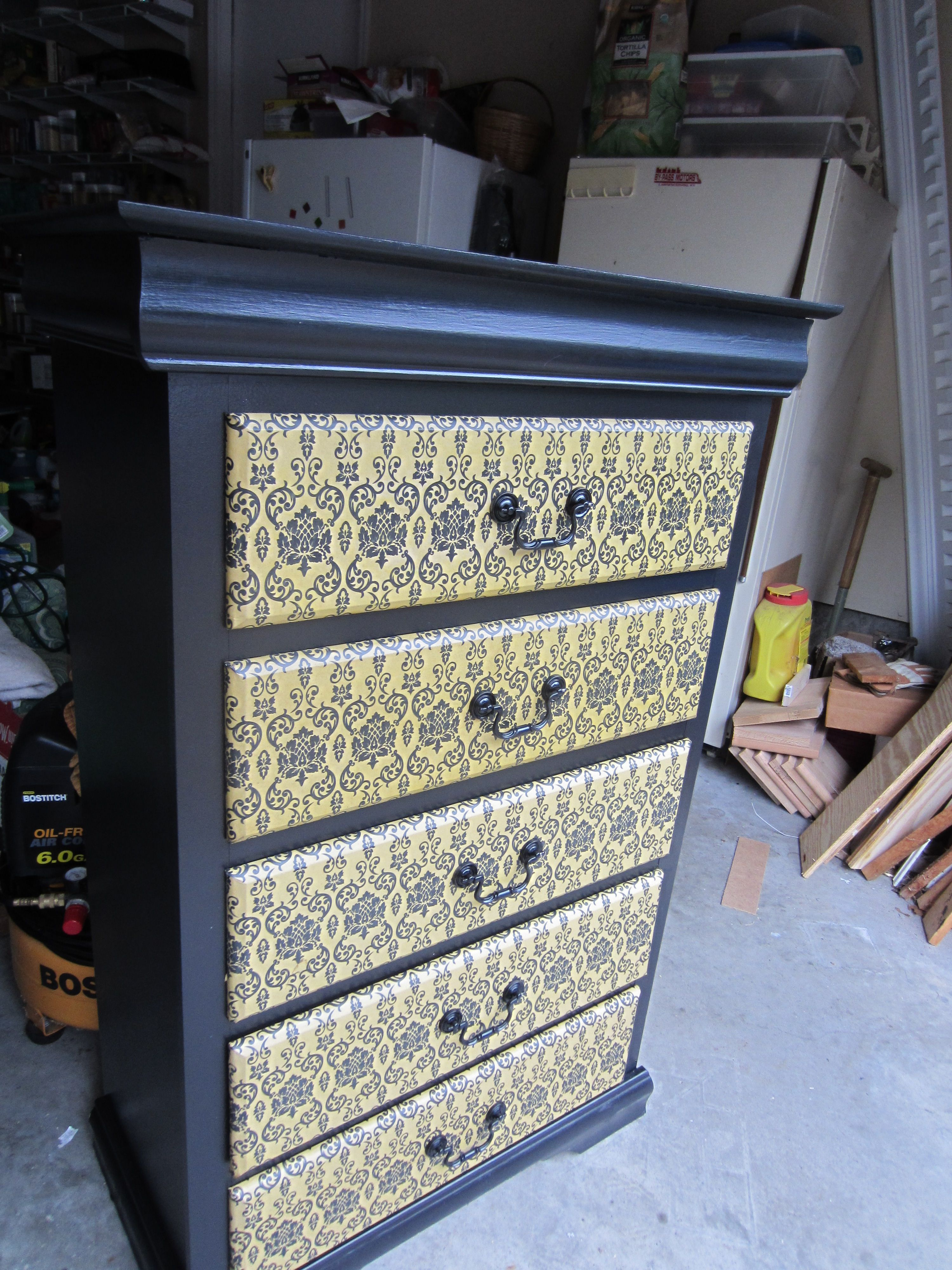 painted and decoupaged drawer fronts of dresser with