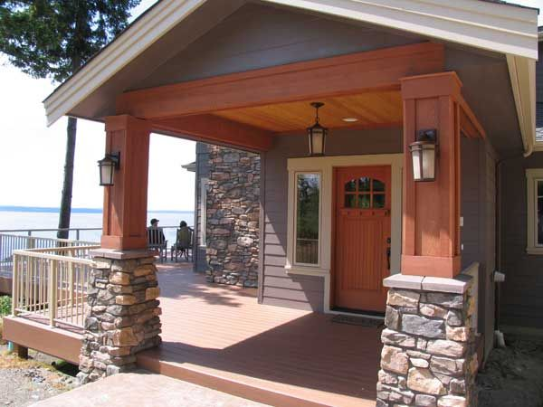 Entry to newly built custom craftsman home with stone and fine woodworking