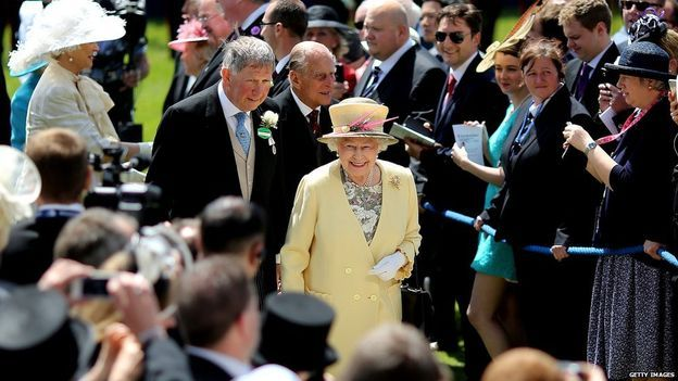 Queen Elizabeth II makes her entrance at Epsom racecourse on June 06, 2015 in Epsom, England.