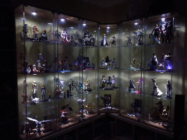 a load of anime manga comic book movie and game figures in a big display case someday w. Black Bedroom Furniture Sets. Home Design Ideas