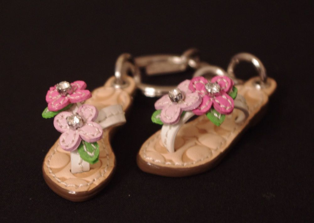 These are cute...but there is no way in hell I'd pay $99.00 for them!!!  Coach Sandals Flip Flops Flowers Rhinestone Crystal Key Chain Fob Charm 65596 #Coach