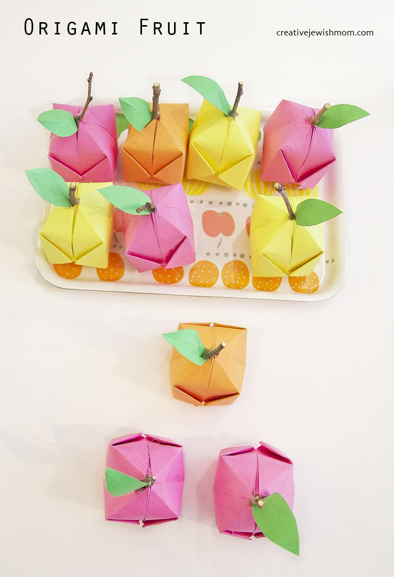Origami Fruit DIY party craft or fun decor idea for a nursery or kid's room. Link to tutorial for making origami balloons, which are great for a variety of crafts.