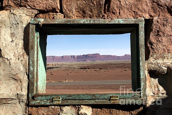 A Room with a View Photograph. A beautiful American West landscape as seen through an antique window frame in an old stone wall.