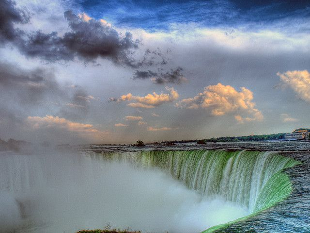 Niagara Falls is the collective name for three waterfalls that straddle the the international border between the Canadian province of Ontario and the U.S. state of New York. They form the southern end of the Niagara Gorge. From largest to smallest, the three waterfalls are the Horseshoe Falls, the American Falls and the Bridal Veil Falls. The Horseshoe Falls lie on the Canadian side and the American Falls on the American side, separated by Goat Island. The smaller Bridal Veil Falls are also