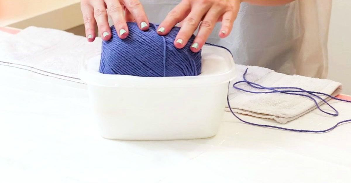 she soaks a whole spool of yarn in glue the result will light up
