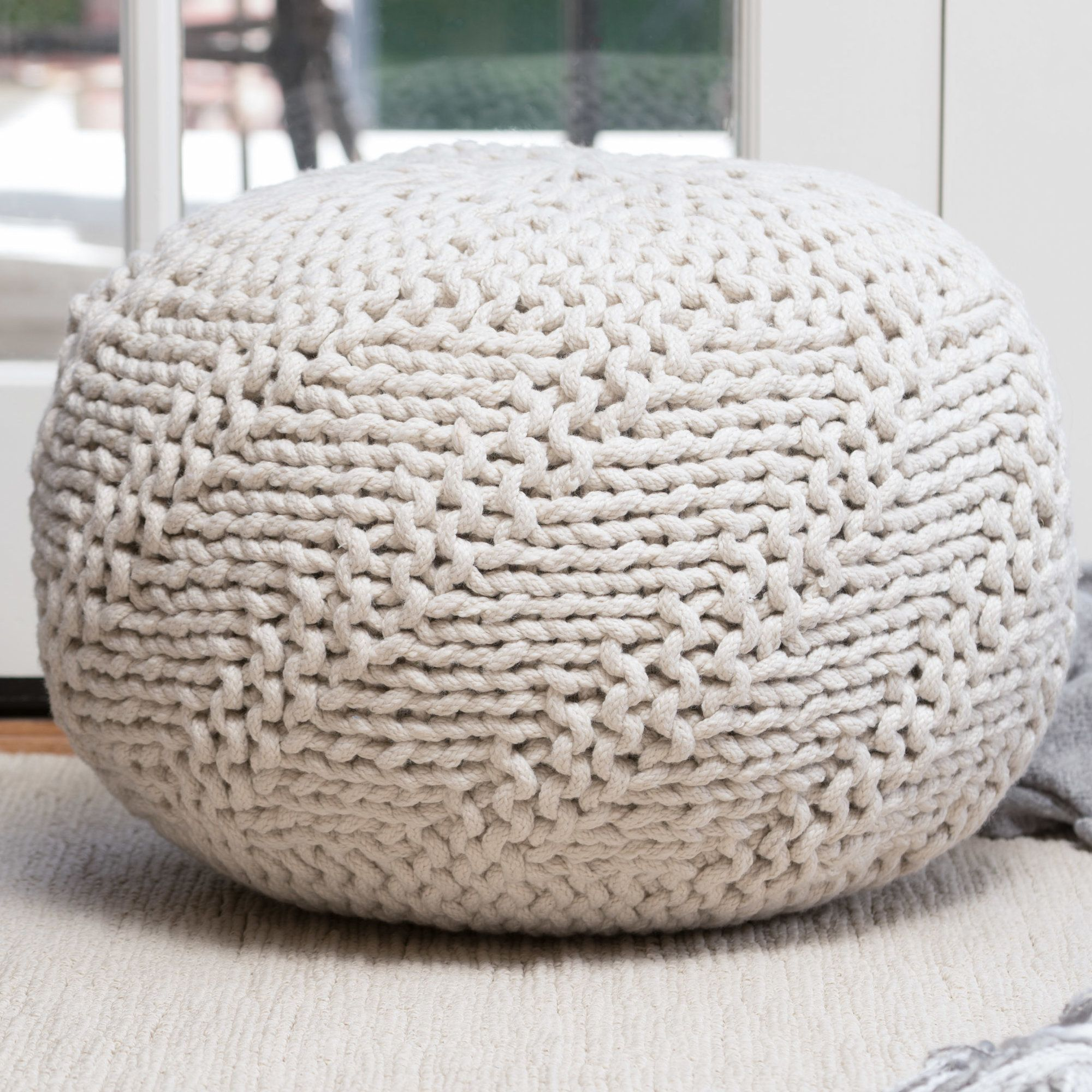This Pouf Draws Attention To Any Arrangement With Its Cool Color