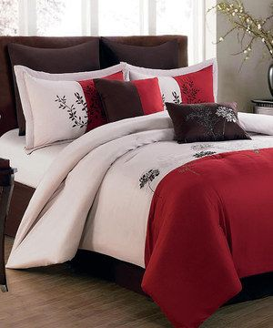 Freshen up the bedroom with this lovely bedding set that instantly upgrades décor with its striking pattern and elegant hues. This chic ensemble includes a comforter, bed skirt, shams and decorative pillows to create a cohesive contemporary look.
