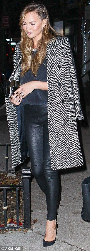 Chrissy Teigen wearing Jimmy Choo Black Anouk Suede & Metallic Leather Degrade Pumps and Saint Laurent Double Breasted Coat