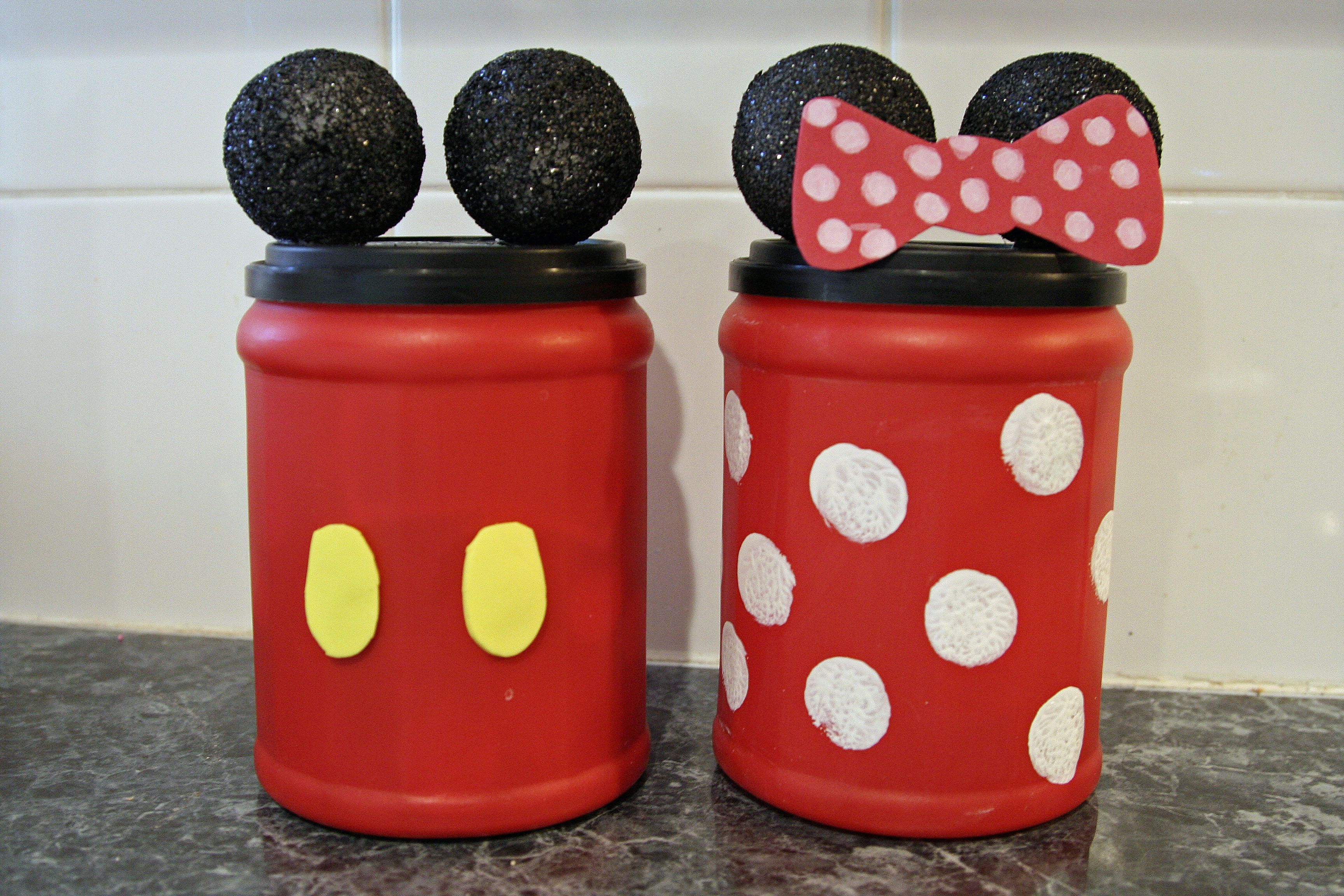 Our change banks for saving money for upcoming Disney World trip.  Made with Folgers coffee canisters, craft foam, paint and styrofoam balls.