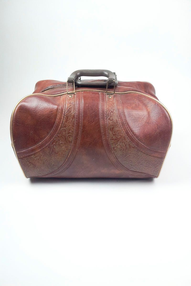 Vintage Tooled Vinyl Bowler Style Tote Suitcase Over Night Luggage Bag. $16.00, via Etsy.