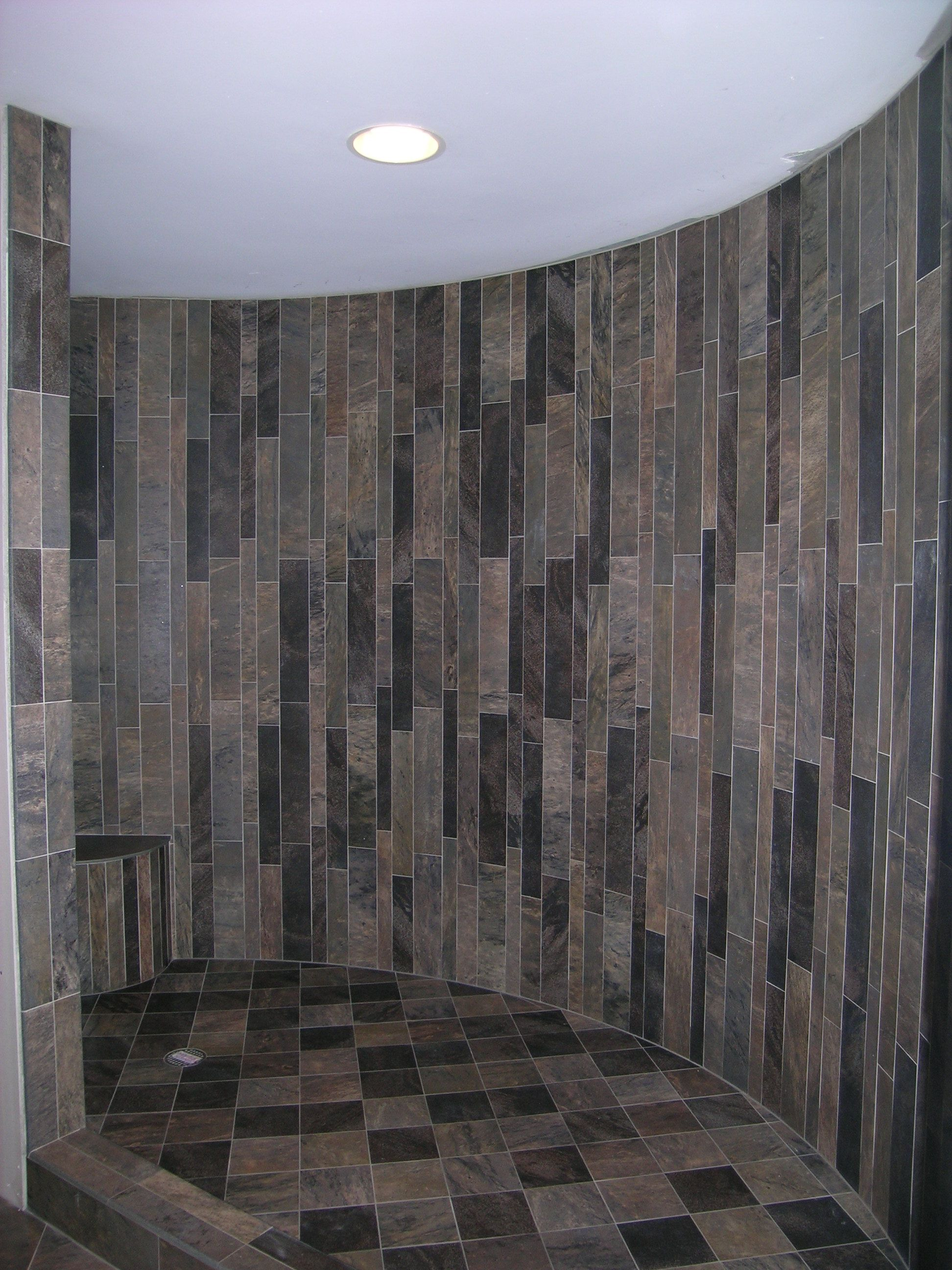 Vertical Strips Of Porcelain Tile Work Really Well On Curved Walls