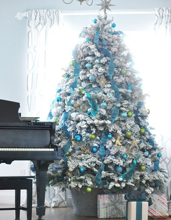 White Flocked Tree Decorating Ideas Blue Gold Green Ornaments Ribbons Blue Christmas Blue Christmas Tree Flocked Christmas Trees