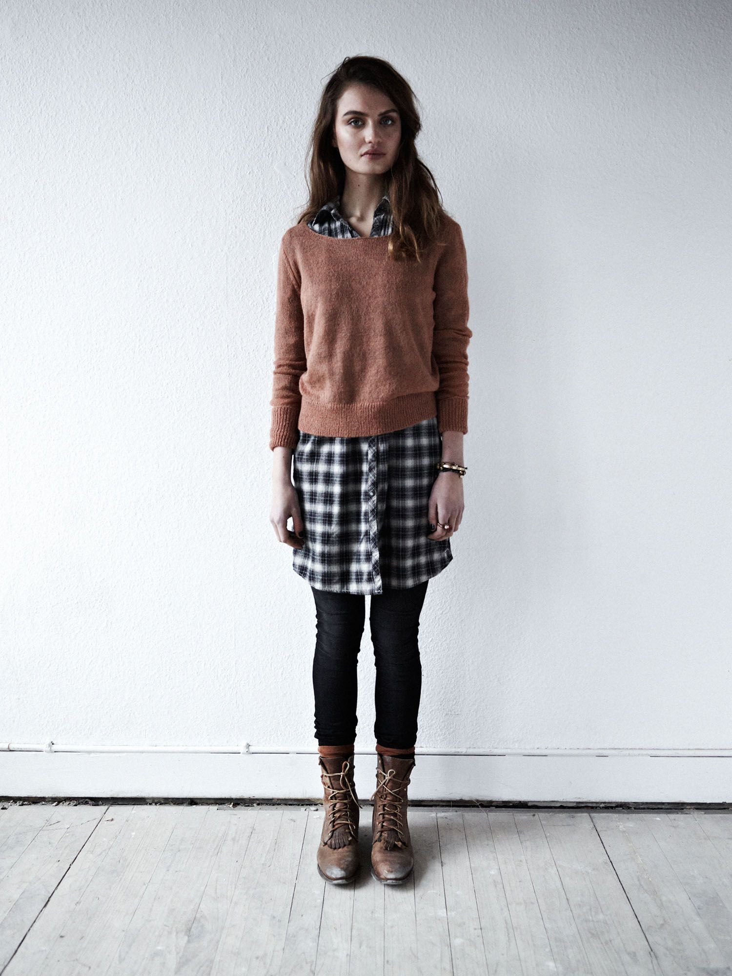 plaid dress shirt, sweater, black leggings, and brown lace-up boots