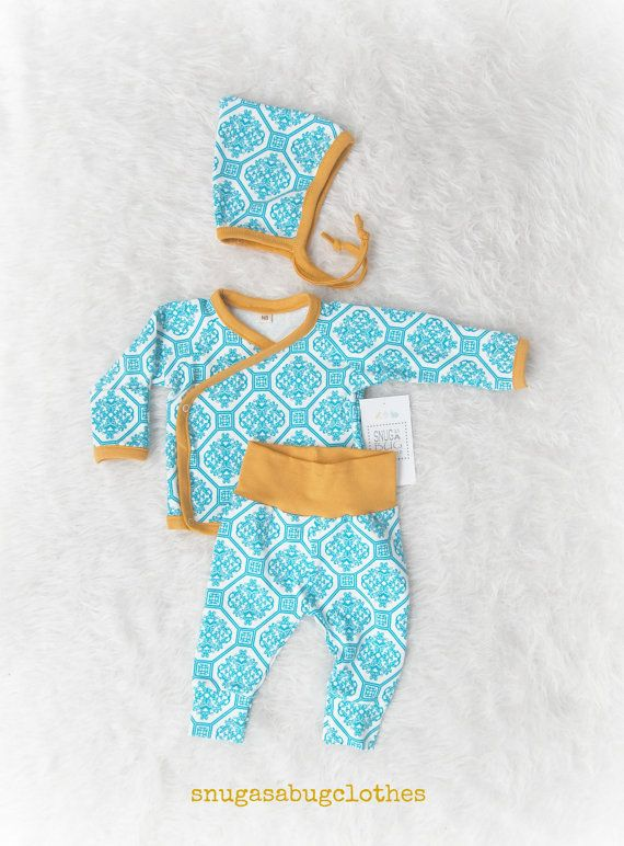 Blue damask tile kimono outfit with mustard trim. Made with 4 quality snaps. Such a sweet set! New style pixie hat with ties. Pants feature a