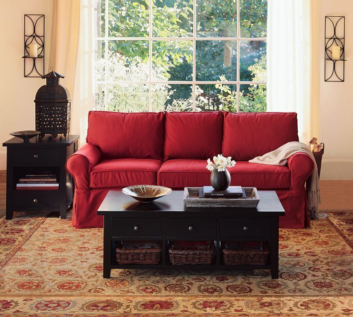 Red IKEA Sofa With Dark End Tables.