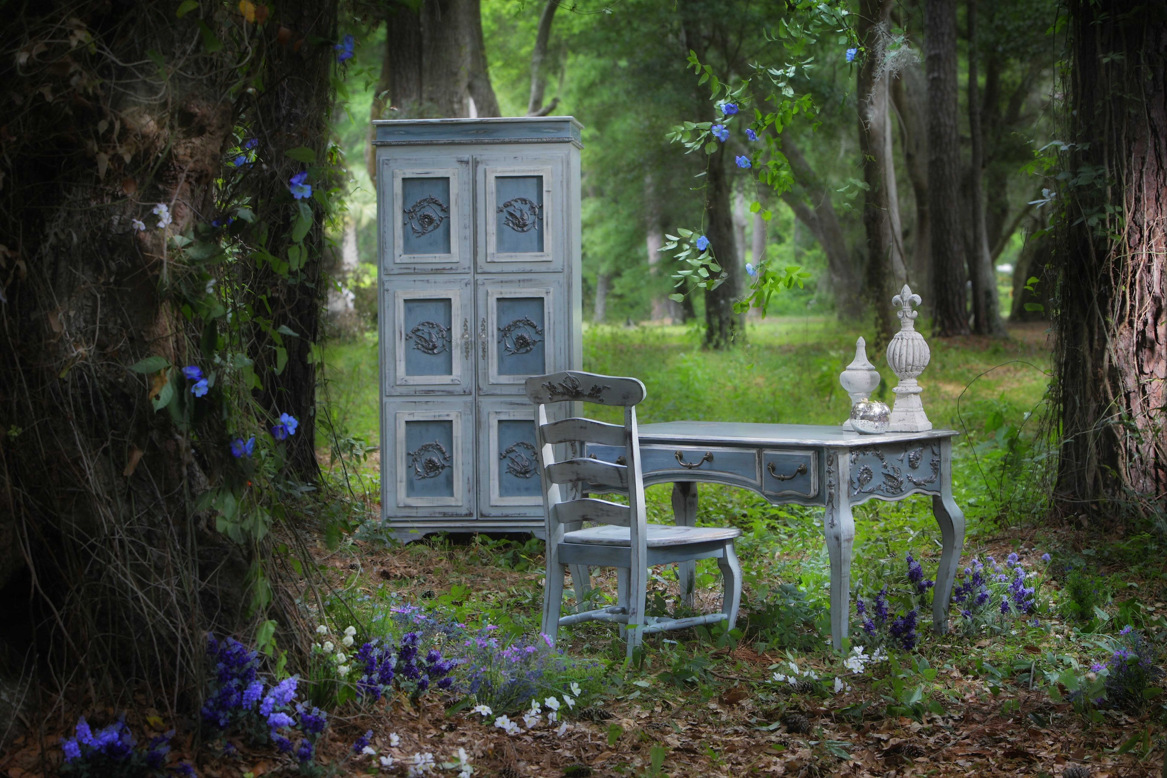 """The """"Sarah Elaine"""" is hand-painted and distressed with beautiful bird embellishments on each door and crystal knobs. Pictured with the Chloe desk & chair. The paint finish is called Blue Haze. Photo by Mark Staff"""