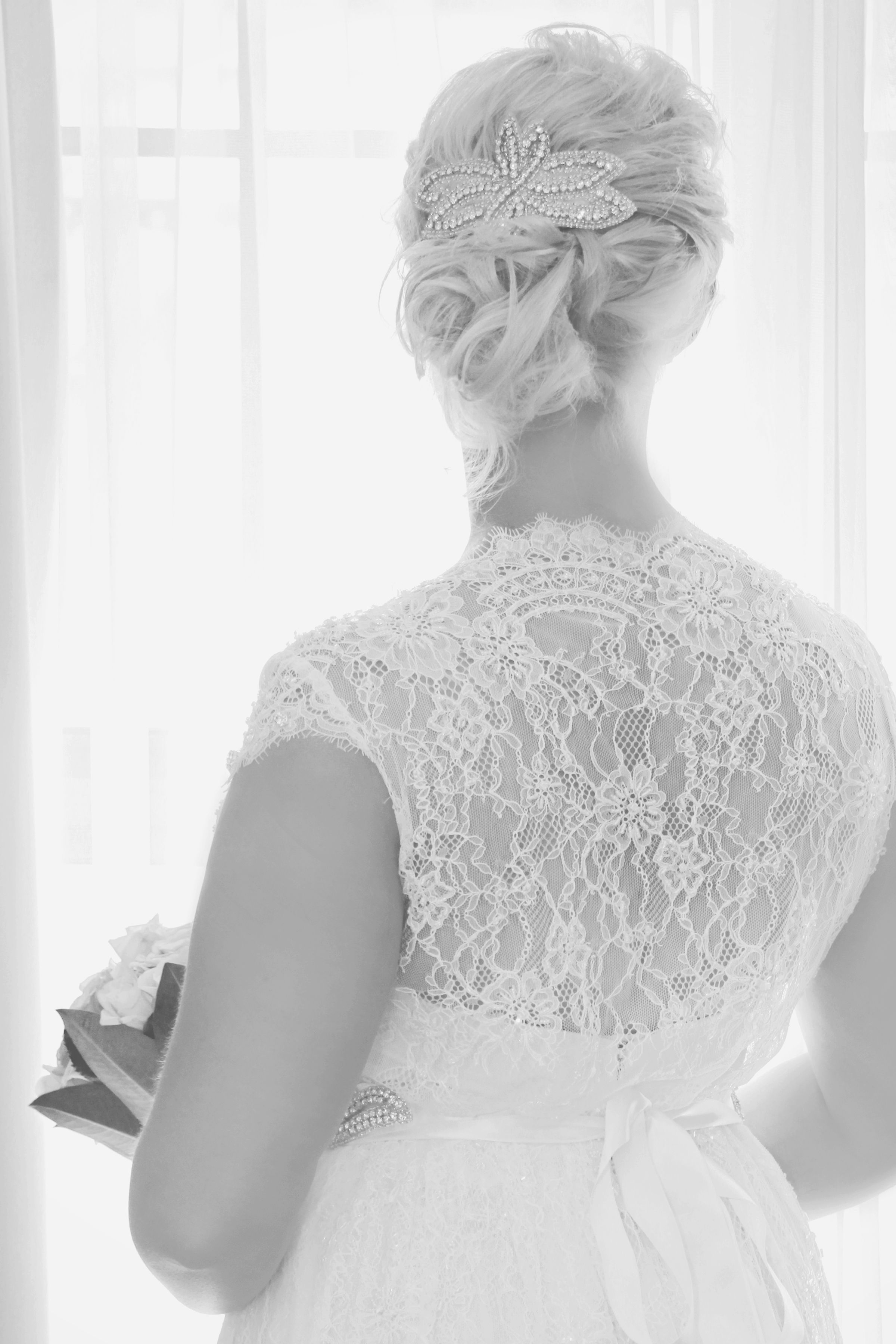 Bridal Hairstyle for vintage inspired wedding- low side curly bun ...