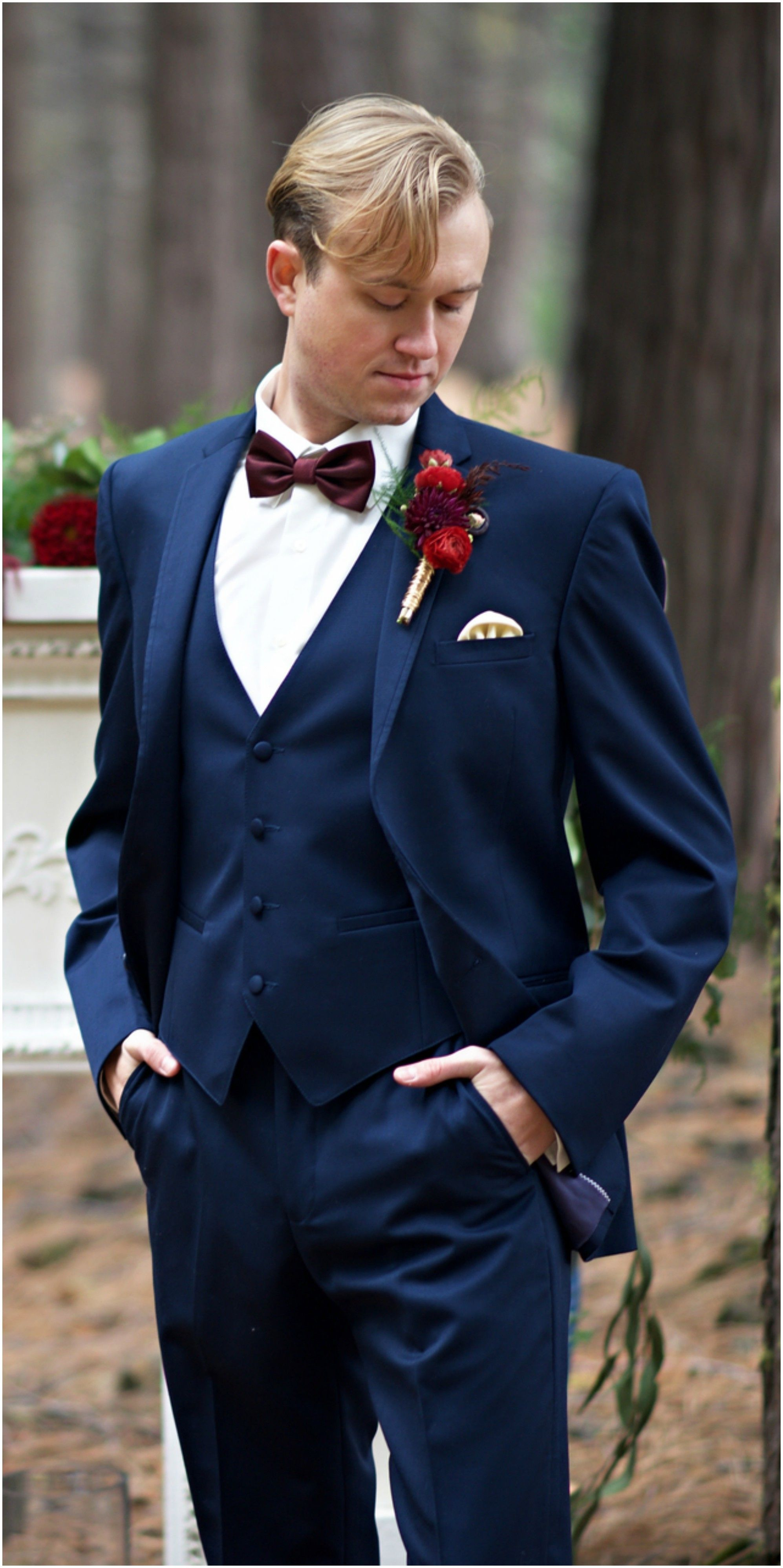 Stylish Groom Attire Navy Blue Suit Red Floral Bout Maroon Bow Tie Modern Image Photography Blue Suit Wedding Navy Blue Groomsmen Navy Blue Suit Wedding