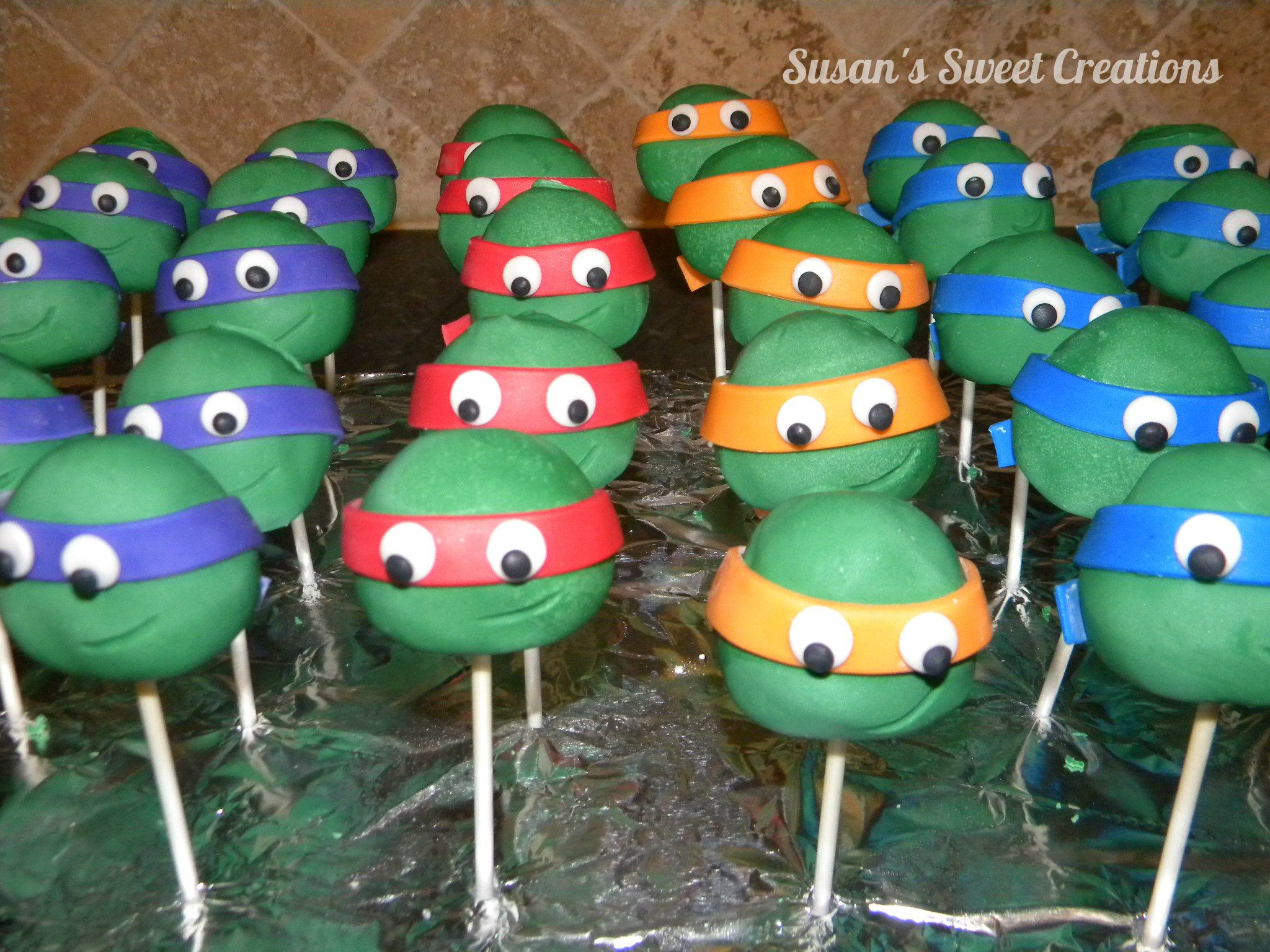 Our Teenage Mutant Ninja Turtle Cake Pops Dipped In Chocolate And Masks And Eyes Made Of Fo Birthday Cakes For Teens Ninja Turtle Cake Pops Ninja Turtle Cake