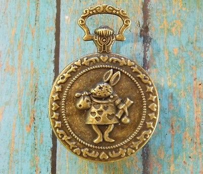 vintage bronze alice in wonderland pocket watch style cabinet
