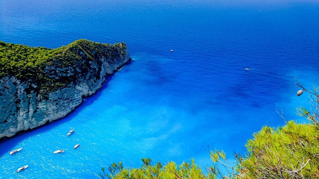 HAPPY NEW YEAR  The beautiful blue Ionian sea at Zakynthos island Greece  Photography by Alistair Ford