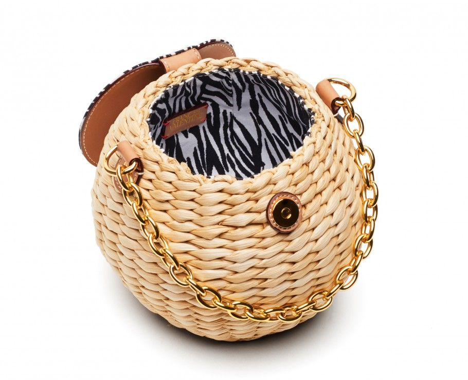 Mini woven honeypot basket with gold chain handle.
